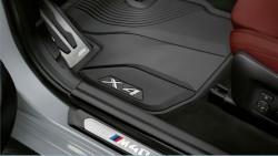 Передні всепогодні килимки BMW.